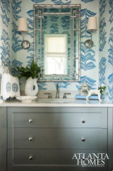 Roberts opted to continue the open-air theme in the powder room with Krane's Banana Leaf wallpaper.