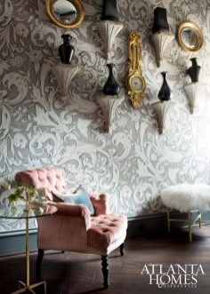 "Lewis & Wood's ornate wallpaper in ""Bacchus"" is complemented by an Italian gilt mirror and an antique tufted chair"