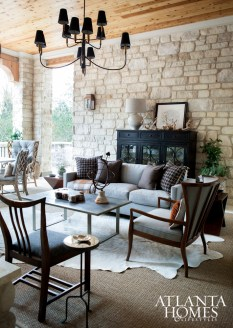 Taking cues from the exterior stonework and leafy views, James Wheeler opted for furnishings with a rugged appeal.