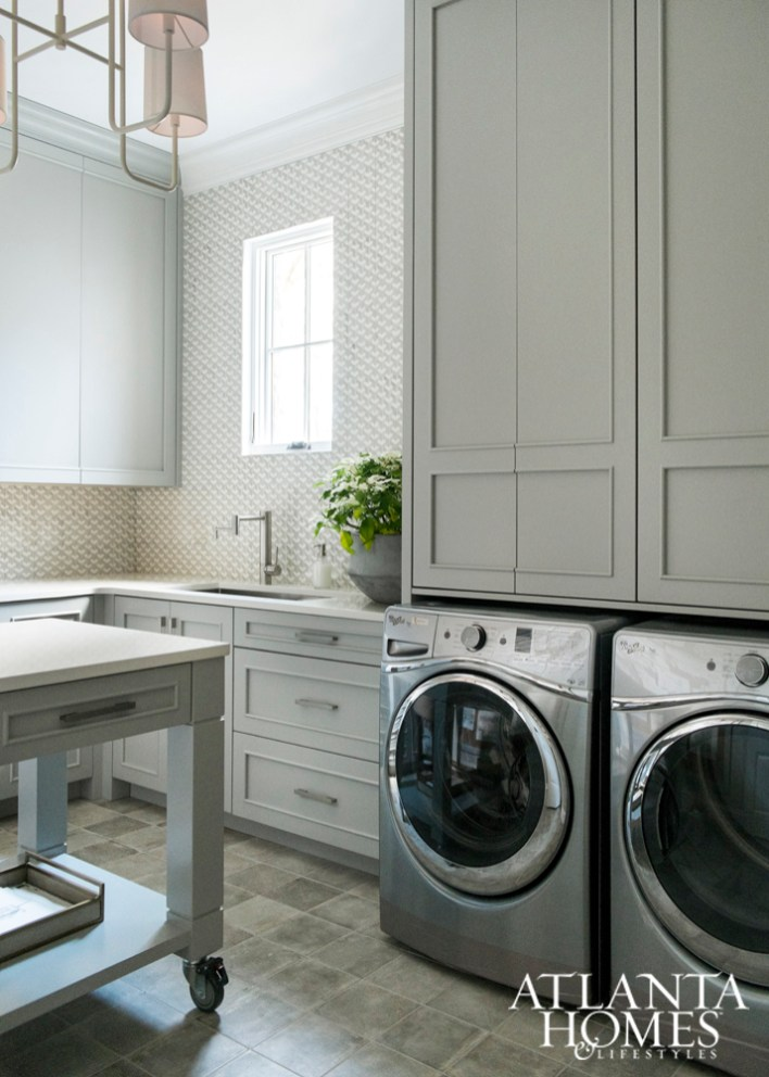 The mix of textures and shapes continues into the laundry and bath.