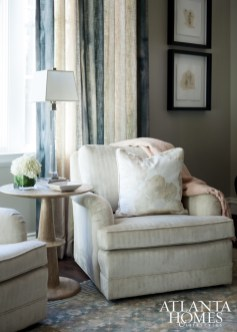 A seating area by the window provides an additional touch of femininity.
