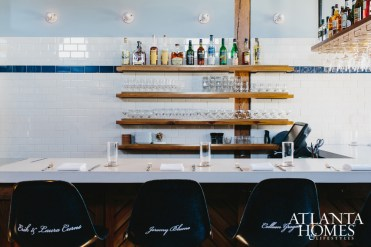 The bar area offers a comfortable place for guests to grab a casual drink or enjoy a meal.