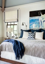 The master bedroom takes its color cues from a Helen Durant painting. The Roman shade was fabricated by Willard Pitt Curtain Makers, and the bedding is by Gramercy Fine Linens & Furnishings.