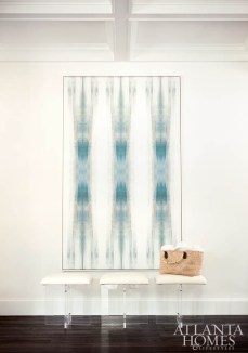 An abstract painting by Carol Benson-Cobb greets visitors in the foyer. The acrylic stools by Moss Studio are available to the trade at Codarus.