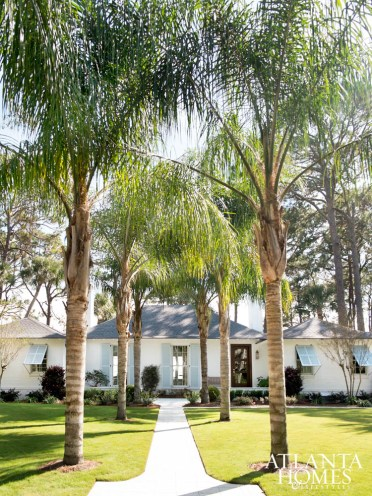 """""""We took advantage of the home's deep front yard, which is rare on Sea Island, by planting palm trees along the front walkway to really create a grand sense of arrival.""""—Rob Kjellander"""