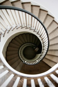The stairway's curves bring an elegant architectural look to the three floors of the home.