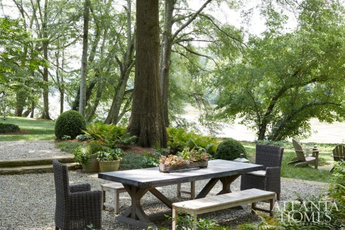 Furniture from RH and West Elm creates a casual dining area overlooking the Chattahoochee River.