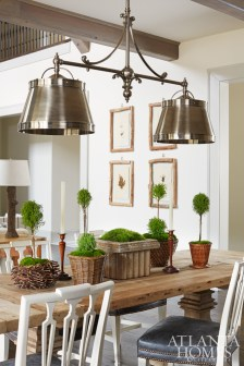 The kitchen, the most popular room in the house, is equipped with a long, family-style dining table and chairs from Restoration Hardware. An industrial double pendant from Visual Comfort adds a hint of masculine texture to the space.