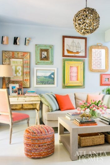 The living room walls are painted Krypton by Sherwin-Williams and the linen-wrapped cocktail table is Kravet. Brian sprinkled in a mix of ready-made pieces from big box retailers, floor models from trade-only showrooms, custom upholstery and professional framing.