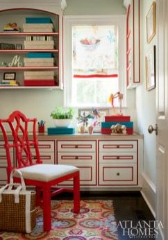 Taking a cue from a magazine image the homeowner had coveted for years, Mathison resurrected a similar home office by choosing cabinetry with thick grooves to paint red.
