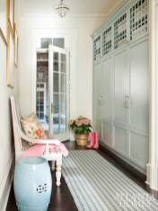 In the mudroom, custom lockers, painted wiith Benjamin Moore's Beach Glass, store everything from sports equipment to work bags.