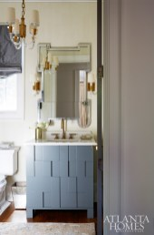 A Julian Chichester mirror and custom vanity by Bradley add a dose of fun to the powder room.