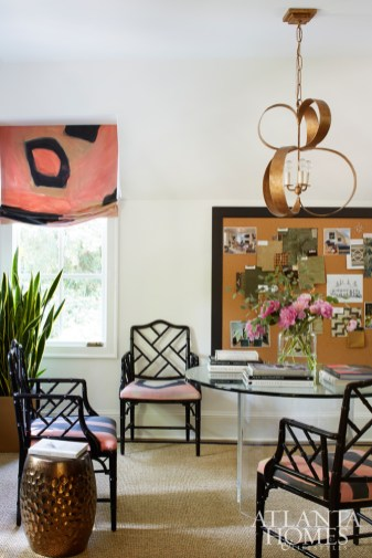 A hand-painted fabric by Porter Teleo—seen here in a Roman shade and on cushions for Chippendale chairs by Jonathan Adler—was the inspiration for Woodbery's home office. Chandelier, Bradley. Stool, Made Goods.