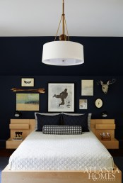 The son's room features a gallery wall of pieces that represent his favorite hobbies, including a Karate figure painting gifted to him by Tom Swanston.