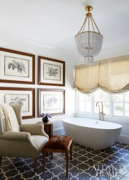 The spa-like master bath features a hand-painted cement tile from Traditions in Tile. Custom mirrors, Brooks & Black Fine Framing. Aerin Lauder chandelier, Circa Lighting. Artwork, Edgar-Reeves.