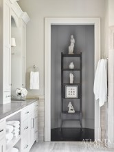 A Barbara Barry for Baker étagère in the master bath highlights plaster maquettes and framed medals.