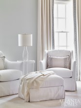 Plush chairs and an ottoman from Bungalow Classic complement the custom headboard.