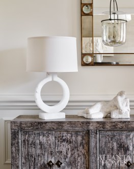 Designer Beth Webb selected a Gansu buffet from Bungalow Classic to display an alabaster lamp and reclining nude plaster.