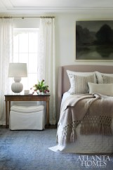 Nancy selected Arnitex's geometric-patterned sheer fabric for the guest bedroom draperies, which allow light to filter into the serene space.