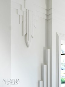 """The front-facing rooms, originally designed to be more formal, feature stylized wall reliefs. """"Art Deco architecture is about playing with crisp shapes,"""" says Ryan of the aesthetic."""