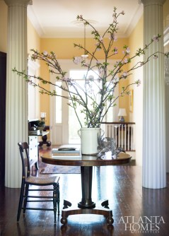 Symmetry abounds in the classic house, where Doric columns, sidelights and 19th-century floorboards original to the Jenkins property yield perfect proportion. Carved birds, Parc Monceau.