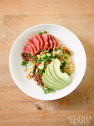 The grain bowl, served with quinoa, seared tuna, cucumber, edamame, kale, avocado, almonds and a sesame soy vinaigrette.
