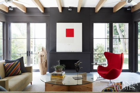 The sunroom of architects Todd Pritchett and Craig Dixon's bungalow offers a stylish window into their home: clean and contemporary but full of character. Sofa, Ligne Roset. Chair, DWR. Custom coffee table, Jeff Jones Design.