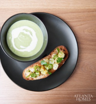 Chilled avocado soup, topped with crème fraiche and served with shrimp toast.