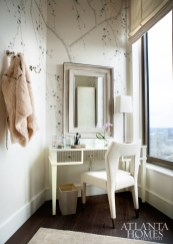 A hand-drawn Prunus pattern on glazed silk paper by Fromental makes a statement in the wife's dressing room; the chair is Natasha Baradaran.