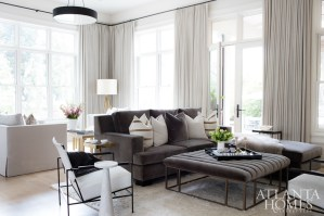 The cozy family room features plush furnishings by Björk Studio plus hide chairs from Oly Studio.