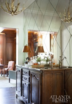 """""""The homeowner loves a good Cosmopolitan, so she wanted a pretty place to craft the cocktail,"""" Dewberry shares about the antique buffet turned bar."""