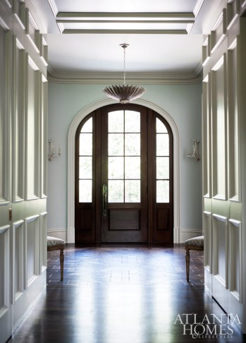 Residential builder McGarrity-Garcia crafted a showstopping entry by incorporating a circular parquet design on the oak floors in the rounded landing.