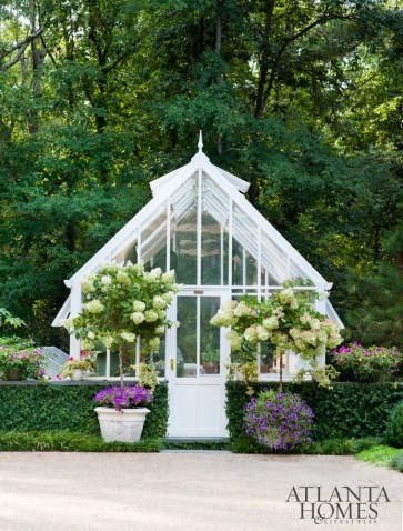 The charming greenhouse was designed by Baker.