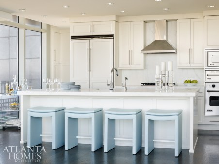 Custom powder-blue leather stools in the kitchen add punch to the space.