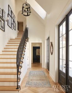 The front entryway features a custom railing in a modern design.