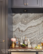 A striking stone backsplash accents the bar off the dining room.