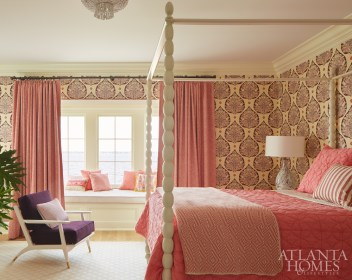 The daughter's bedroom is pretty in pink and purple, featuring a Galbraith & Paul wallpaper, Schumacher drapery and a purple chair from Bungalow 5.