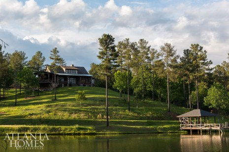 """As with most properties, it's the location that matters most. The lake """"wraps this house so that it feels somewhat situated on a peninsula,"""" says Summerour, who designed the 45-degree-angle cantilevered porch to engage with its panoramic views. """"That's an unusual feature to be attached to what otherwise would be called a South Carolina vernacular–style cabin architecture,"""" the architect explains."""