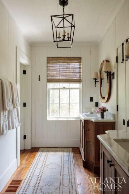 In the master bathroom, Millner enlisted Willis Everett of Vintage Lumber to build his-and-hers vanities.