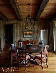 In this Keith Summerour–designed hunting retreat, designer Melanie Millner of The Design Atelier enlisted Atlanta furniture designer Kevin Scanlon to build the 84-inch round dining table, which seats 10 comfortably. Jason Smith of Smithworks Iron & Design crafted the iron chandelier hanging above.