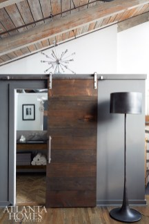 An oversize black metal floor lamp by Regina Andrew sits pretty next to the newly minted master bath door.