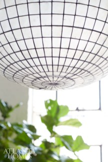 Restoration Hardware's shell light pendant captures the loft's unique and modern aesthetic.