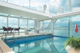 Aboard the Emerald Star, an infinity pool—highly unusual for a river cruise ship—converts to a movie theater at night.