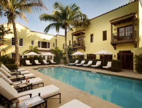 The enclosed garden pool offers a private paradise away from the hustle and bustle of the town.