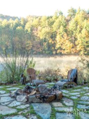 A rearfirepit takes advantage of the lakeside location.