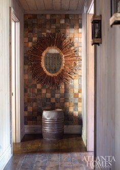 At first glance, the wall at the master bedroom entrance looks like tiles, but it is actually the ends of varying wood pieces of barn wood.