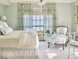With its shades of pale blue, crystal chandelier and sumptuous textiles (namely, Hodsoll McKenzie draperies), the master bedroom is a serene retreat.
