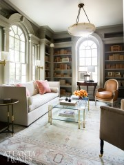 """Always sensitive to a home's interior architecture, Kasler created calm in the library with a gorgeous gray stain. """"I just love the patina of that room. It's cozy without being heavy."""" Rug, Moattar. Sofa, Dessin Fournir through Ainsworth-Noah."""