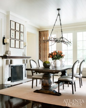 Paul Ferrante's Branch chandelier enjoys pride of place in the breakfast room, which opens to the south-facing loggia. Botanical prints, Holland & Co. Custom fire screen, Smithworks.