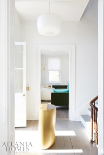 The classic Charleston layout is apparent upon stepping inside Jim and Kay Douglass' new coastal refuge, which might be one of the many reasons why they like to head to their Holy City home at least once a month. The curvaceous brass occasional table accenting the third-floor foyer is from Holland & Company.